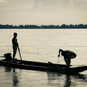 Fisher people work along the Mekong River in Cambodia.