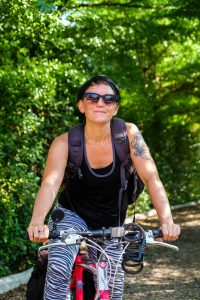 Earth Rights Defenders Coordinator Tessa de Ryck bicycles to ERI's office in Chiang Mai, Thailand.