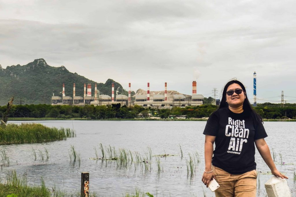 EarthRights International Mekong Legal Bertha Fellow Chompoo in front of the Mae Moh coal-fired power plant.