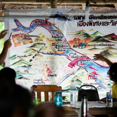 "This map titled ""Chiang Khong - Special and Amazing City"" - was made by members of Rak Chiang Khong. Jeerasak Inthayod, a Rak Chiang Khong team member, explains their work and tactics, including campaigning and legal strategies, to stop both the Pak Beng dam on the Mekong River and projects to blast apart rapids on the Mekong to make room for Chinese riverboat transportation. The Pake Beng dam would displace 6,700 people and is one of 11 dams planned for the lower Mekong – a cascade of development that threatens the food security of 48 million people."