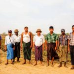 A group of the 33 farmers on their land near Thilawa Special Econoimc Zone in Myanmar.