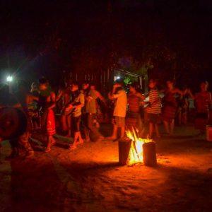 The villagers perform a folk dance show.