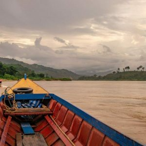 Boats carry people and goods up and down the Mekong River near Chaing Khong, Thailand.