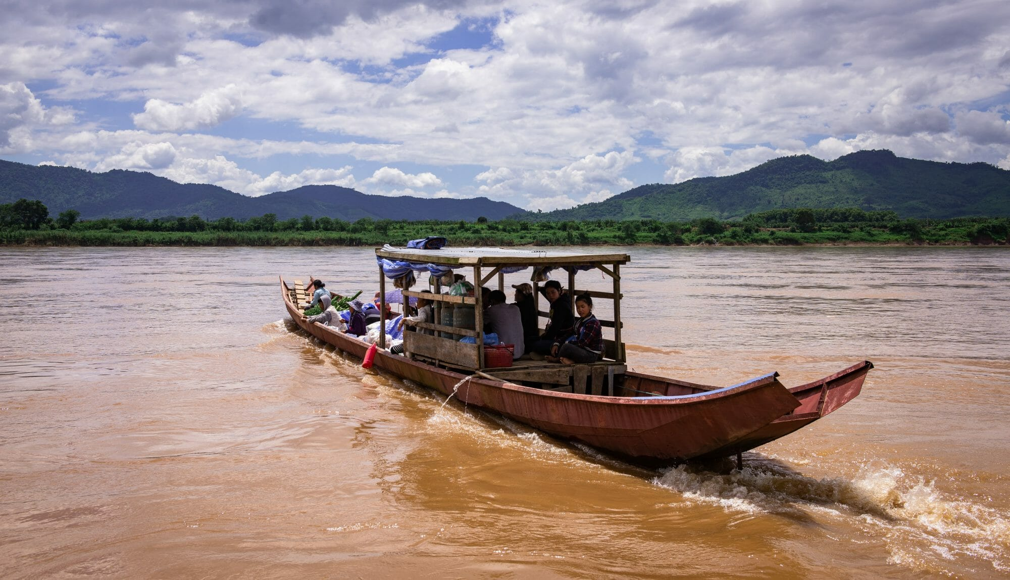 A boat crosses the Mekong River in northern Thailand near Chiang Khong.