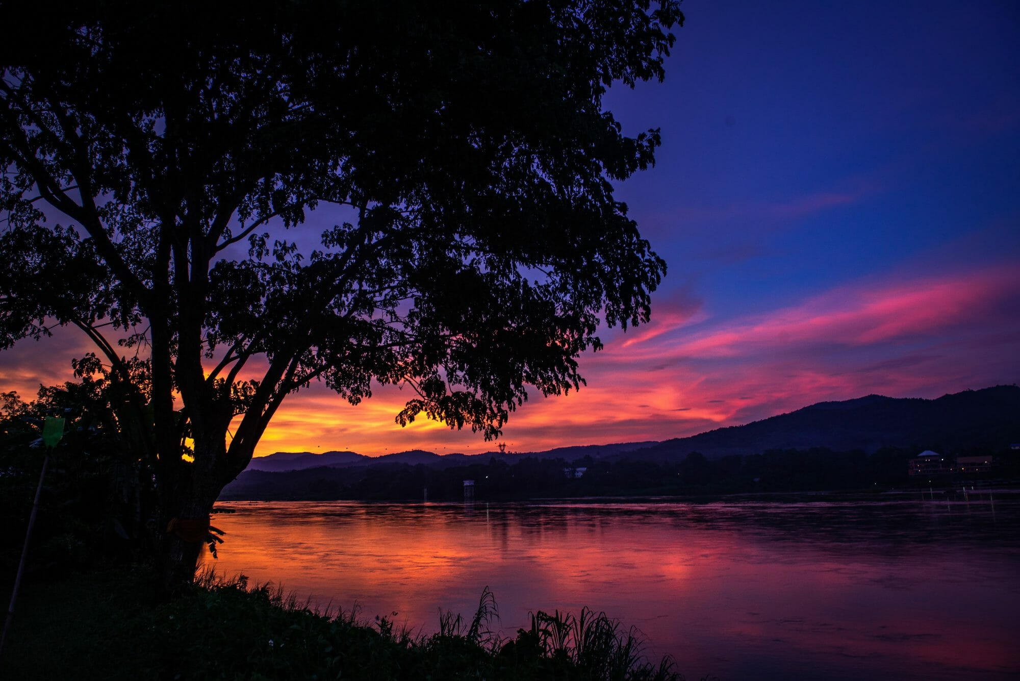 The sun sets on the Mekong River on the Thai-Lao border near Chiang Khong, Thailand.