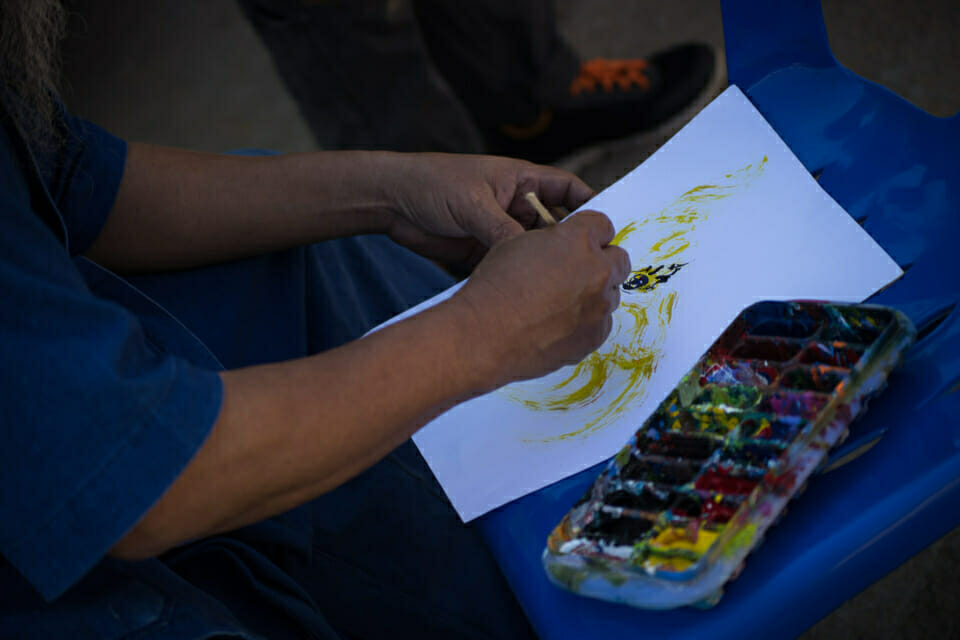 Local artist painting a Naga, symbol of the campaign. Following the Thai folklore, Naga a mythical, serpent like creature is the guardian of the Mekong River.