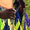 During the event every participant placed a colored flags on the riverside as a symbol of collective effort.