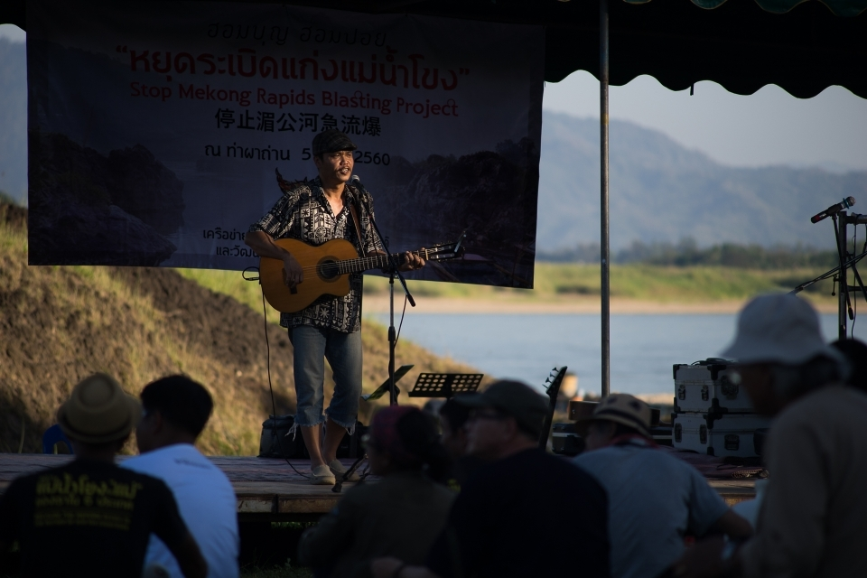 A musician from At North, Rajaphat Chiang Rai University performing for the participants.