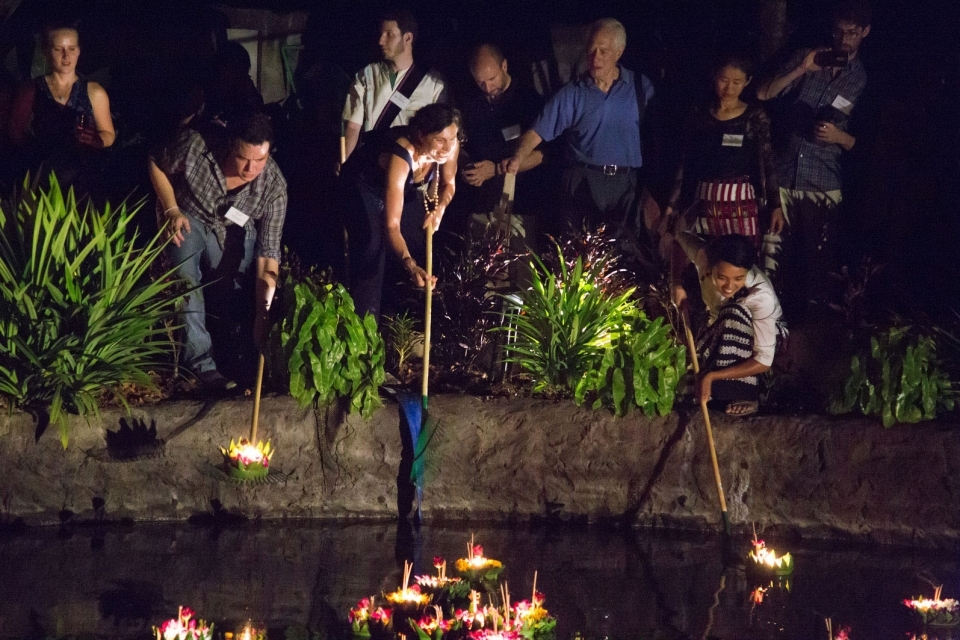 ERI staff and supporters float flower baskets on the rainwater pond at the Mitharsuu Center.