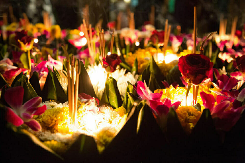 As night fell, staff and supporters released krathongs, floating flower baskets, on the rainwater pond.