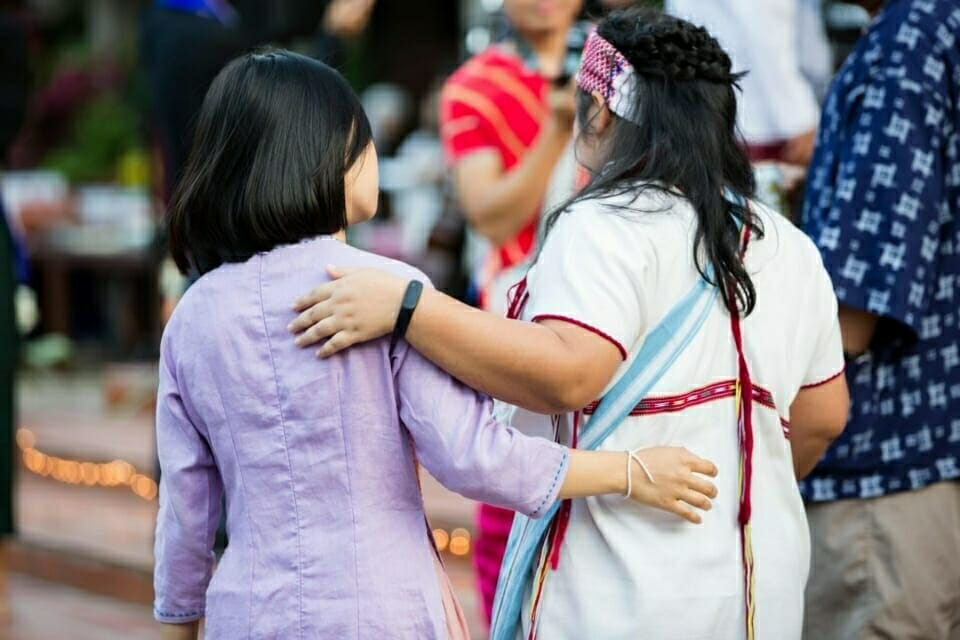 Strategic organizing, movement building, and leadership development are crucial tools to protecting natural resources. Building networks and solidarity will keep activists stronger together for the future. In this picture, a Vietnamese and Karen-Thai student in their traditional clothes stand together at their graduation ceremony.