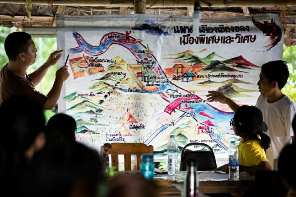"""This map titled """"Chiang Khong - Special and Amazing City"""" - was made by members of Rak Chiang Khong. Jeerasak Inthayod, a Rak Chiang Khong team member, explains their work and tactics, including campaigning and legal strategies, to stop   both the Pak Beng dam on the Mekong River and projects to blast apart rapids on the Mekong to make room for Chinese riverboat transportation. The Pake Beng dam would displace 6,700 people and is one of 11 dams planned for the lower Mekong – a cascade of development that threatens the food security of 48 million people."""