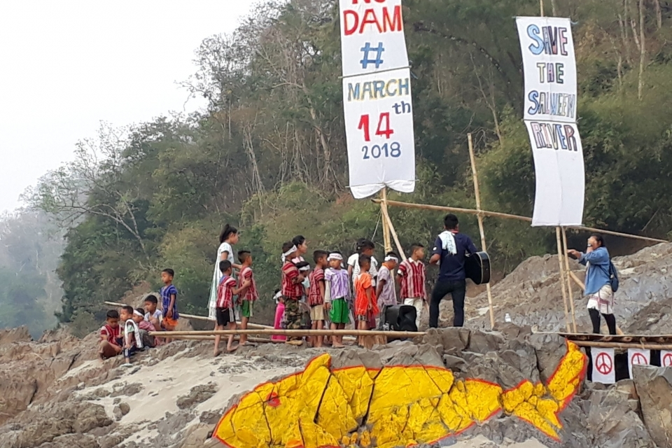 Local communities gather near the site of the proposed Hatgyi dam on the Salween River to protest the project.