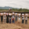 """Supporters of the Dawei communities pose in the dry riverbed of the Myaung Puio River, asking """"Where has the river gone?"""" (In Myanmar language (Burmese), """"Myit bae pyauk twar thar hlae?""""). Since the Heinda Tin Mine (https://goo.gl/gEr66N) began operation nearby, the river has gone dry. Today, only irrigation channels remain."""