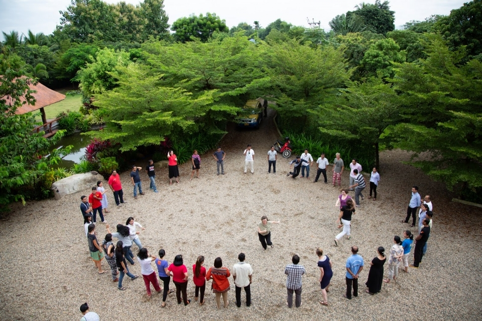 Participants play a game to get to know one another. The Forest Defenders Conference provided chances for earth rights defenders to build relationships and strengthen networks of solidarity.