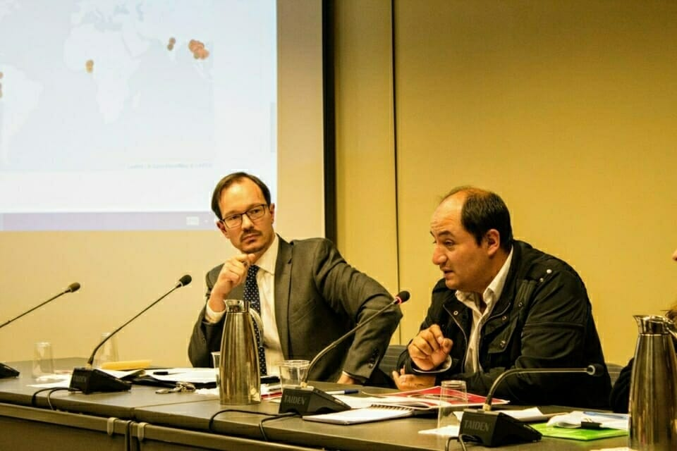 Milton Sanchez, right, discusses the physical and legal threats earth rights defenders face in Peru.
