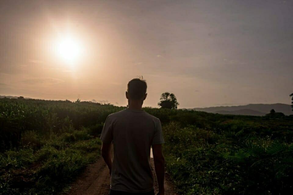 EarthRights School teacher Brendon Thomas walks through the fields at Ban Haeng.