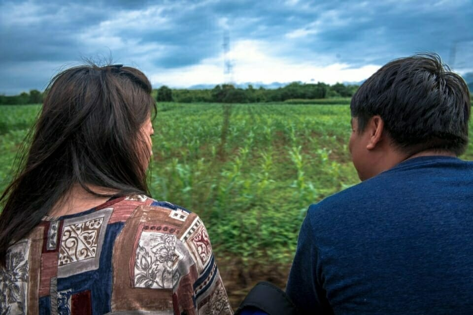 EarthRights staff members look out over the fields of the Ban Haeng community.