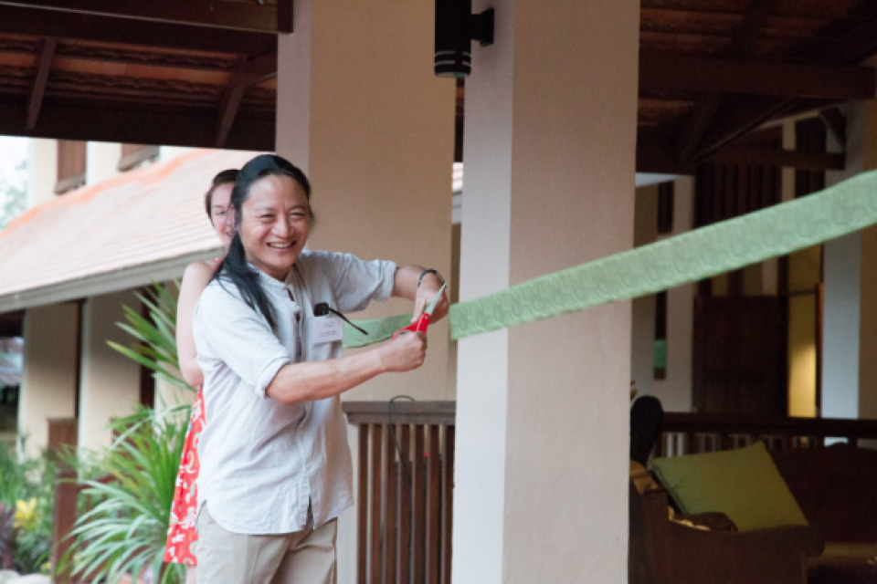 Co-Founder and Executive Director Ka Hsaw Wa cuts the ribbon at the entrance to the Mitharsuu Center, officially opening its doors to staff, partners, and students.