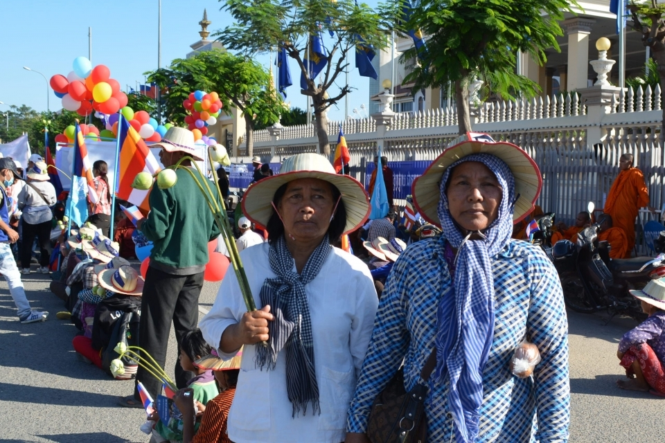 Im Hean, 62 and Pheng Sophal, 64, attended the International Human Rights Day March because they would like the world to hear about the issues that are affecting their human rights. They have been asked to relocate without compensation due to a coming railway project.