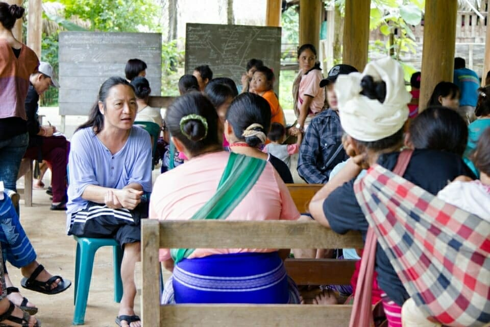 Ka Hsaw Wa, ERI co-founder, and Executive Director translates from Karen language to English, during the community meeting.