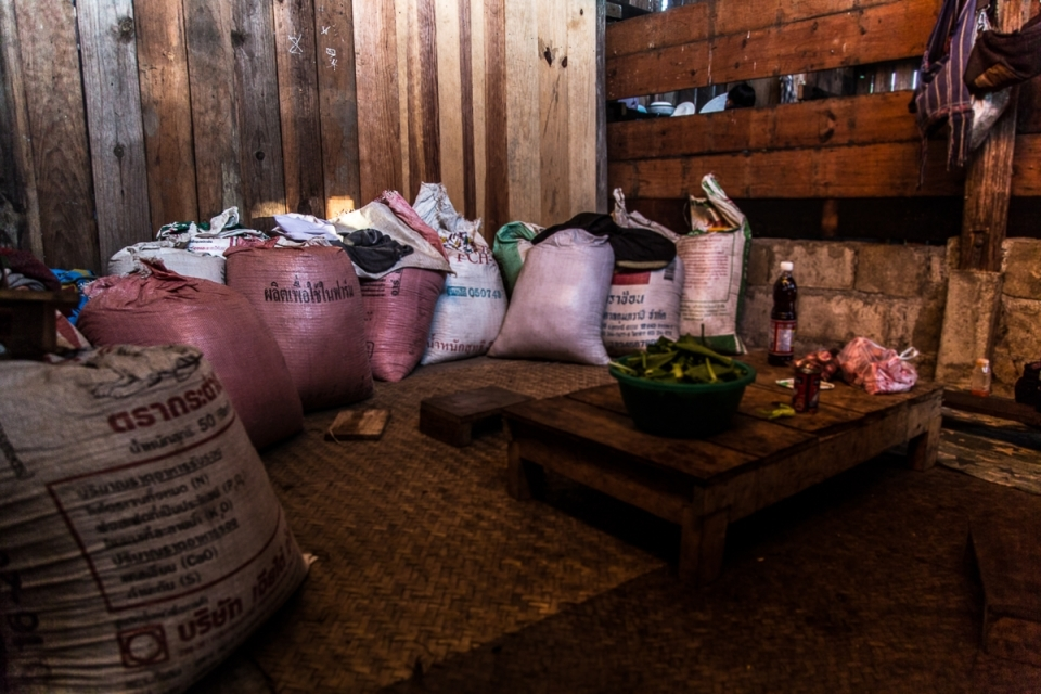Rice bags in a local house at Nong Tao Village. Rice plantations provide an income for Karen communities and are a symbol of and source for traditions.