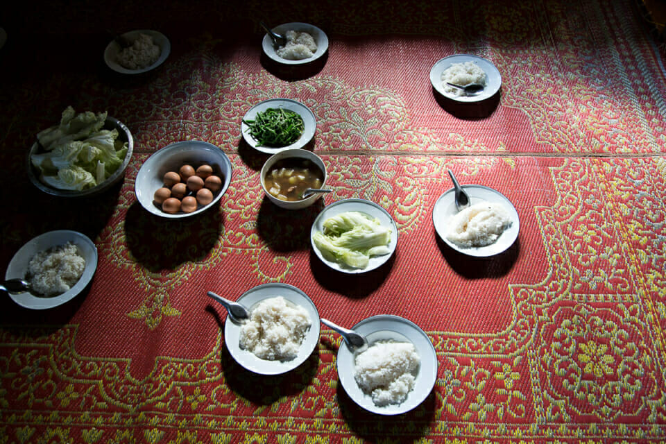 Meal at Nong Tao Village. Contract farming is endangering Karen's traditional agriculture techniques such as their rotation system to protect the soil.