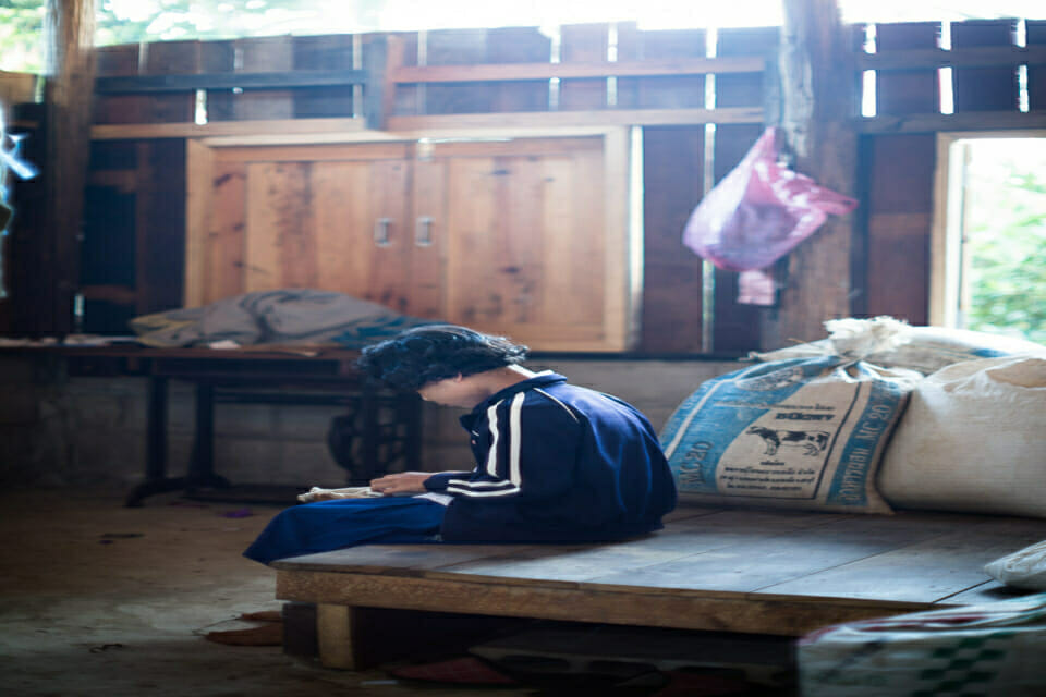 Karen girl at her house before going to school. Karen combine traditional ways of education with modern schools.