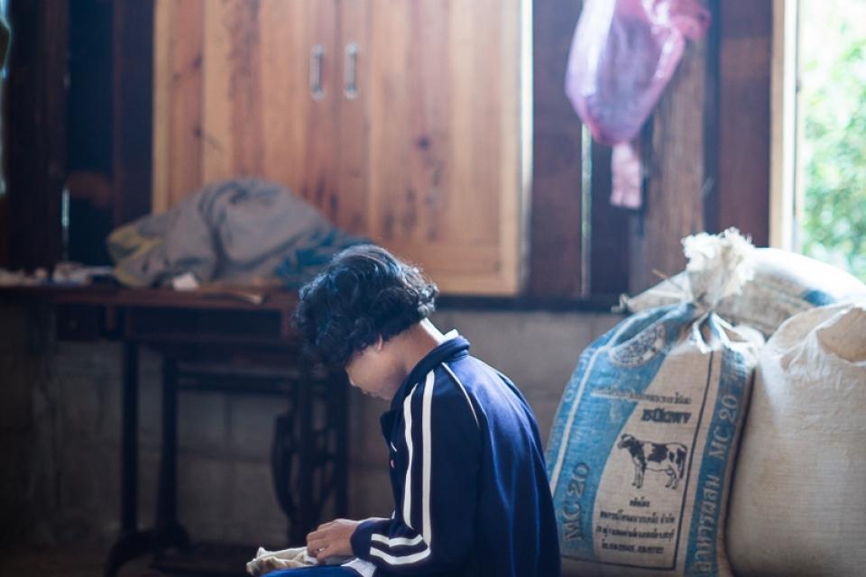 Karen girl at her house before going to school. Karen combine traditional ways of education with modern schools.