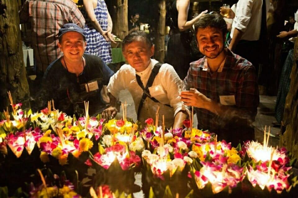 ERI Training Director Billy Doerner, Mekong-Myanmar Regional Managing Director Chana Maung, and Amazon Program Lawyer Pablo Abdo pose with krathongs.