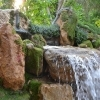 The grounds of the Mitharsuu Center include a recirculating waterfall and a rainwater-collection pond.