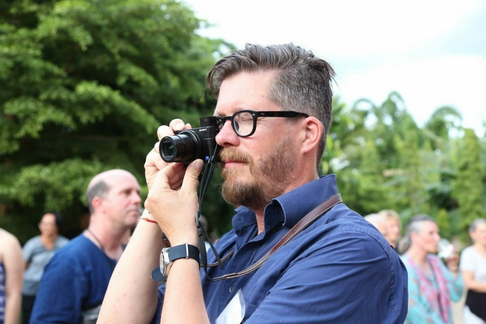 Board Member Jasper Tuelings, General Counsel at Greenpeace International, takes pictures during the ceremony.