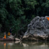 A rock marks the beginning of Pha Tang, a fish conservation area in the Yom River. Every year a monks perform a ceremony to bless the area, ensuring the community's laws will be respected by locals and visitors.