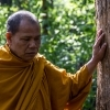 The Venerable Chaisit, conservation monk from Sa-iab Village in teak forest. Religious beliefs help the communities in Kaeng Sua Ten in their struggle against the dam. They are Buddhist and have animism beliefs and practices, which means that they attribute souls to plants, animals, and natural phenomena.