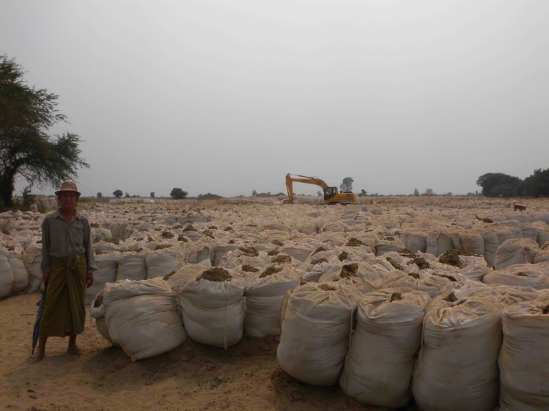 Sandbags completely covering a villager's land beyond the initially agreed to area
