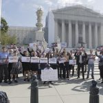 Human rights advocates rally outside the Supreme Court on Oct 1, 2012