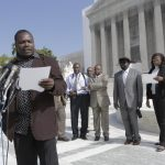 Plaintiff Charles Wiwa speaks with press outside the US Supreme Court