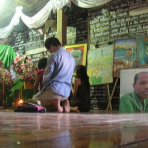 A local temple with signs and paintings memorializing activist Charoen Watakson