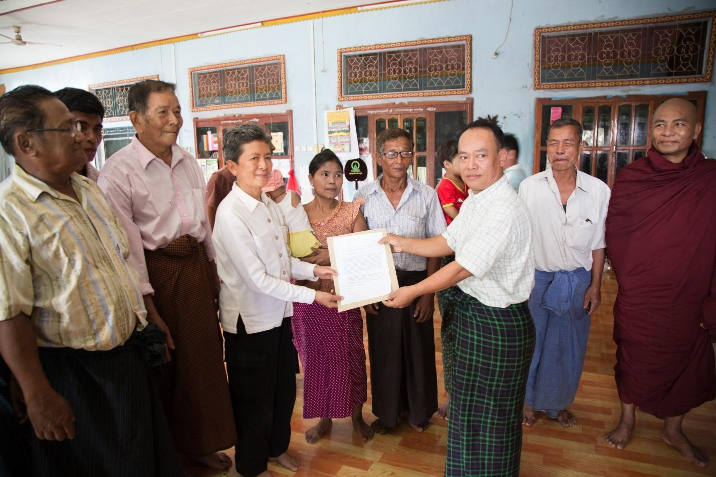 A representative of CSO groups and villagers submitted a petition to Ms. Tuenjai Deetes (middle), Commissioner of the National Human Rights Commission of Thailand on 25 February 2017 at Maying Gyi village