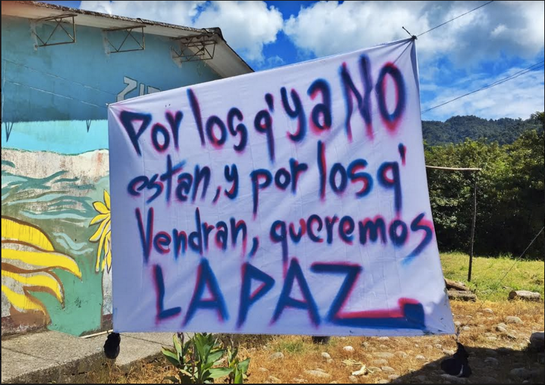 "A sign in the U'wa village: ""For those who are no longer here, for those who will come, we want peace"""