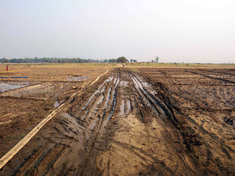 A road damaged by construction vehicles, Mu Can village, April 2012